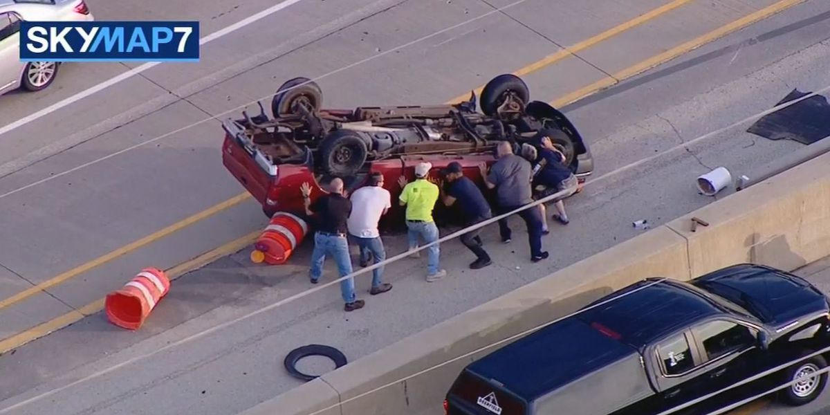 Good Samaritans rescue driver of overturned pickup truck on interstate near Chicago