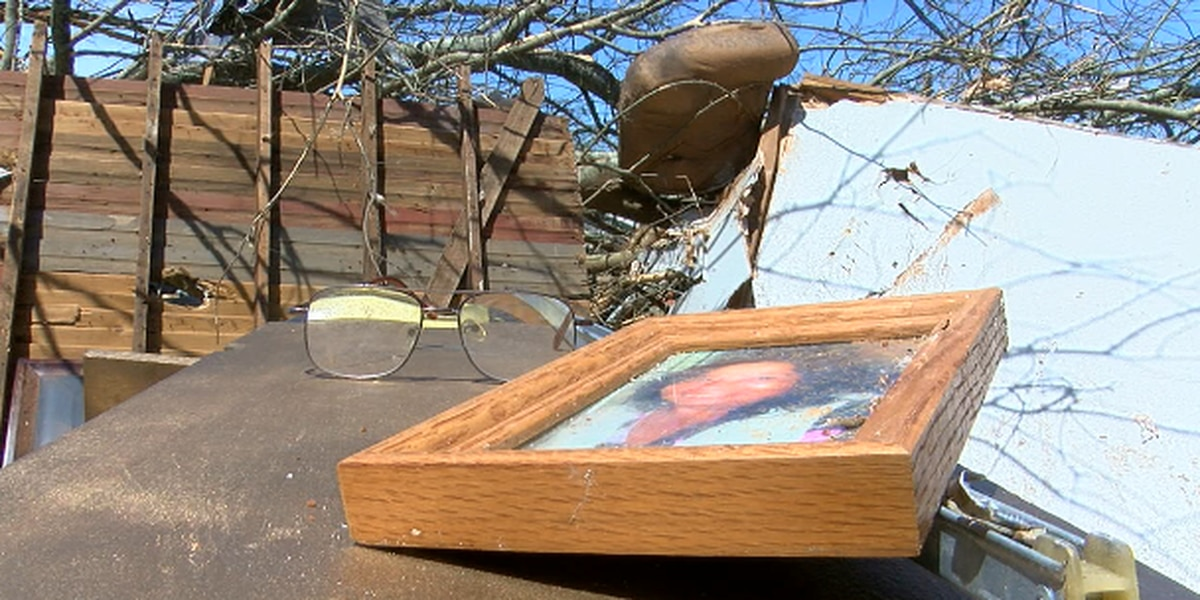 Cherokee County family could only save a few family photos after devastating storm