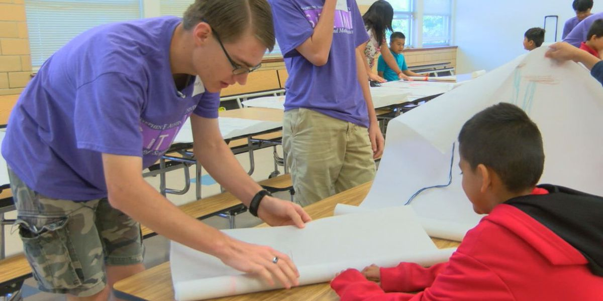 High school students mentoring kids as part of SFA's STEM Academy