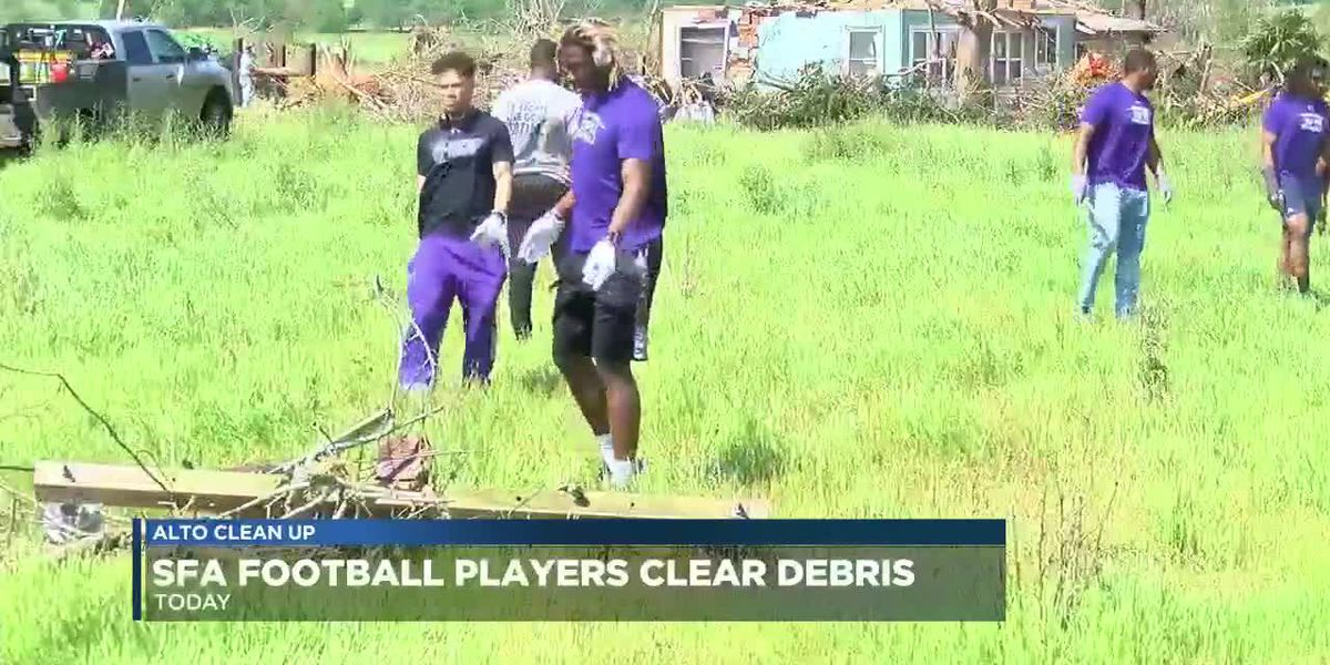 SFA Football teams lends muscles to Tornado clean up efforts