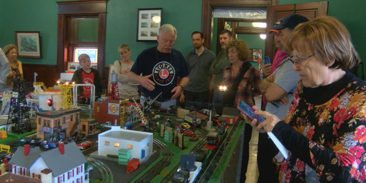 Model train engineer says, 'All aboard', in Nacogdoches