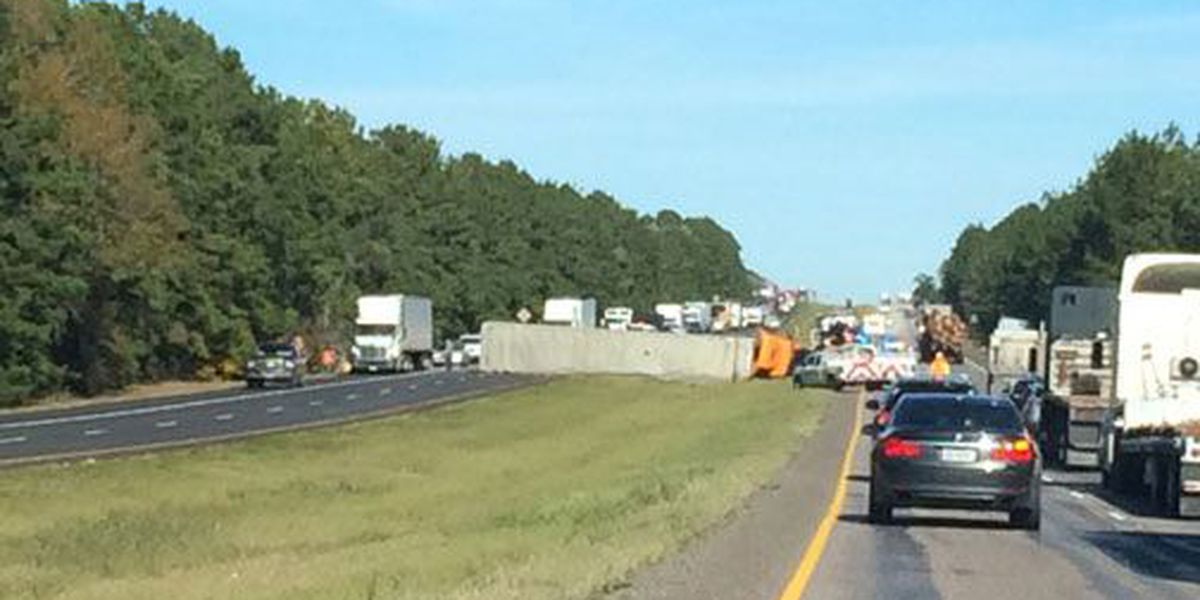 Overturned 18-wheeler slowing traffic on US 59 in southern Polk Co.