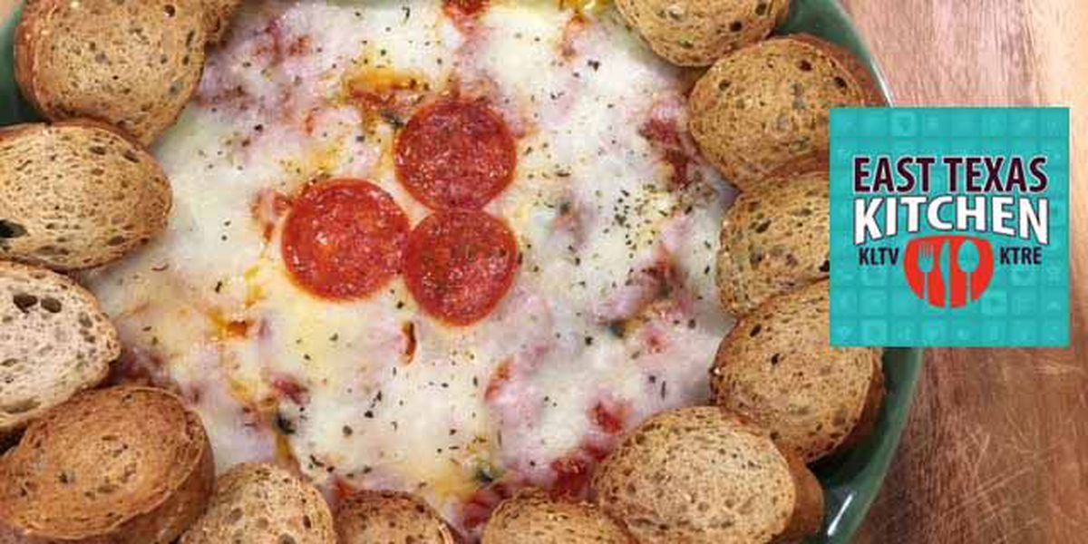 Hot pizza dip with garlic baguette rounds