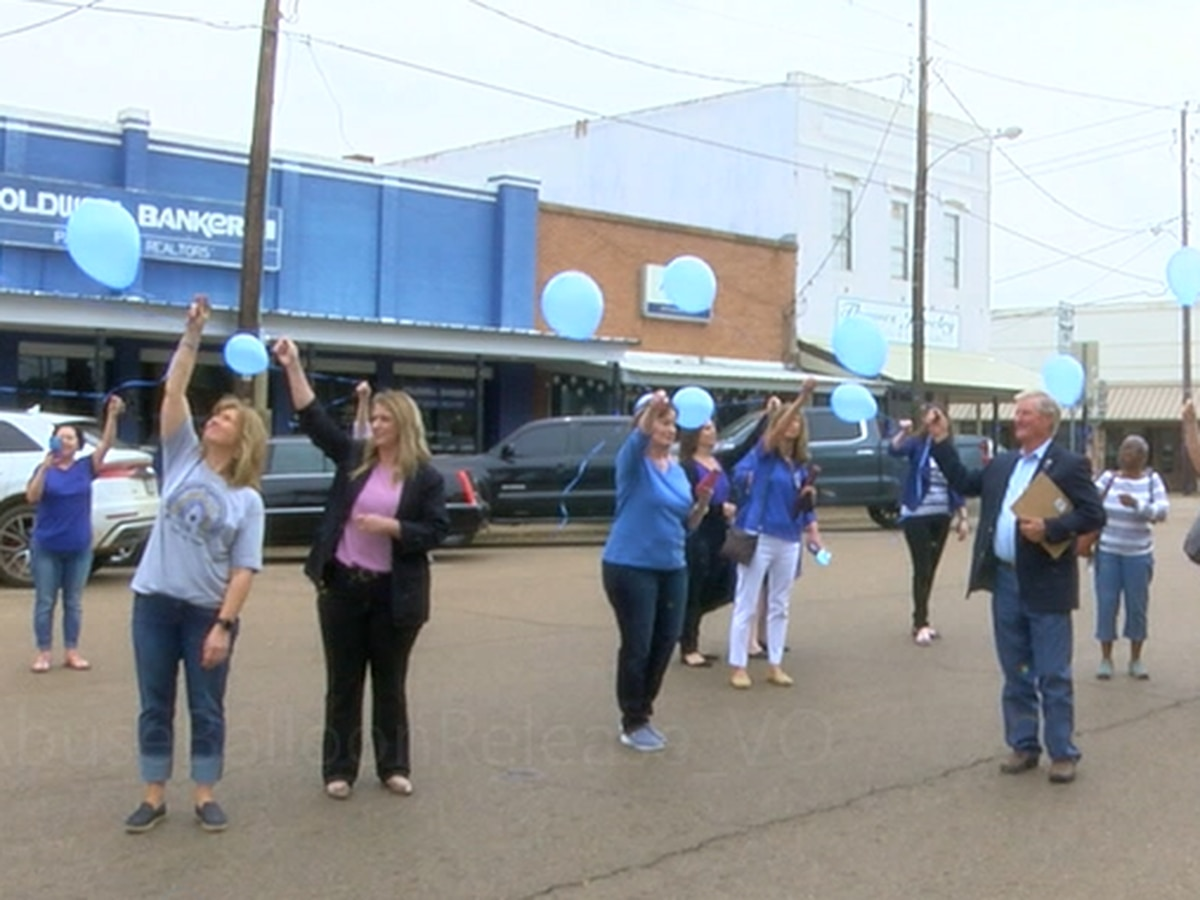 Houston County residents release blue balloons in honor of child abuse victims