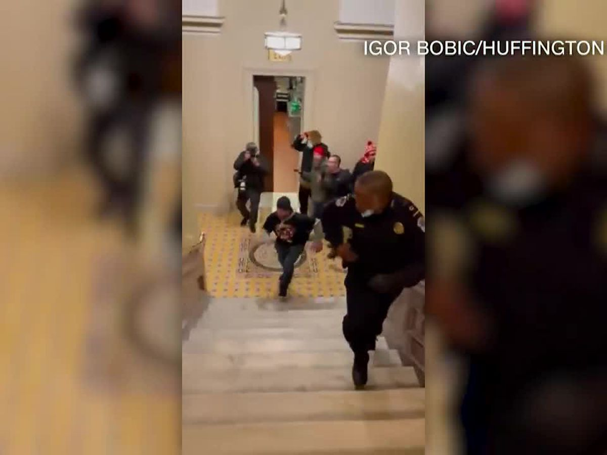 Officer credited with keeping rioters from Senate chambers stays silent