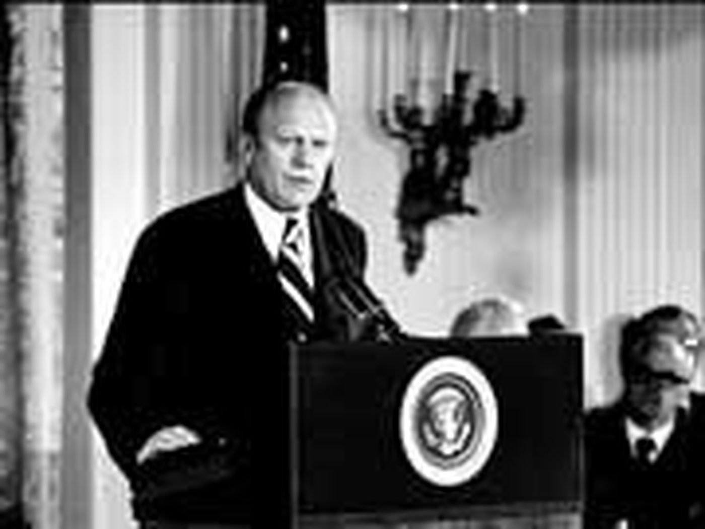 Pres. Gerald R. Ford addresses an audience in the East Room of the White House after being sworn in as the 38th president of the United States on Aug. 9, 1974 following the impeachment of Pres. Richard Nixon. (AP Photo)
