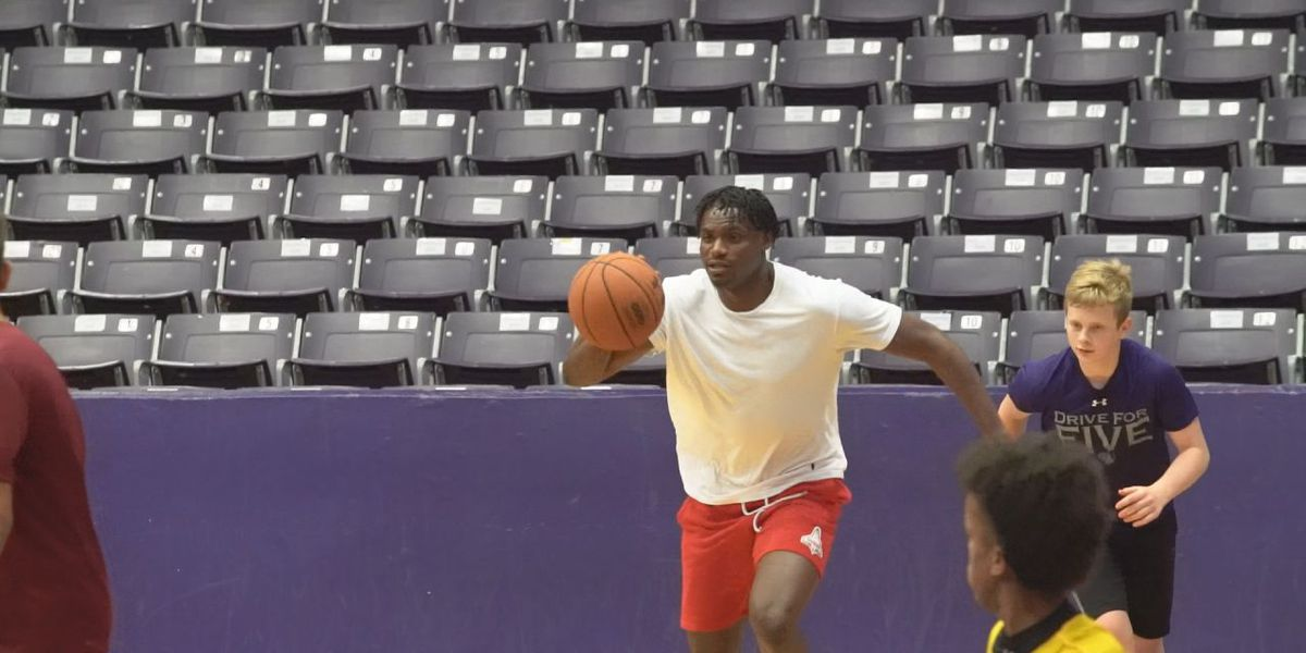 NBA Free Agent Danuel House helps out with SFA youth basketball camp