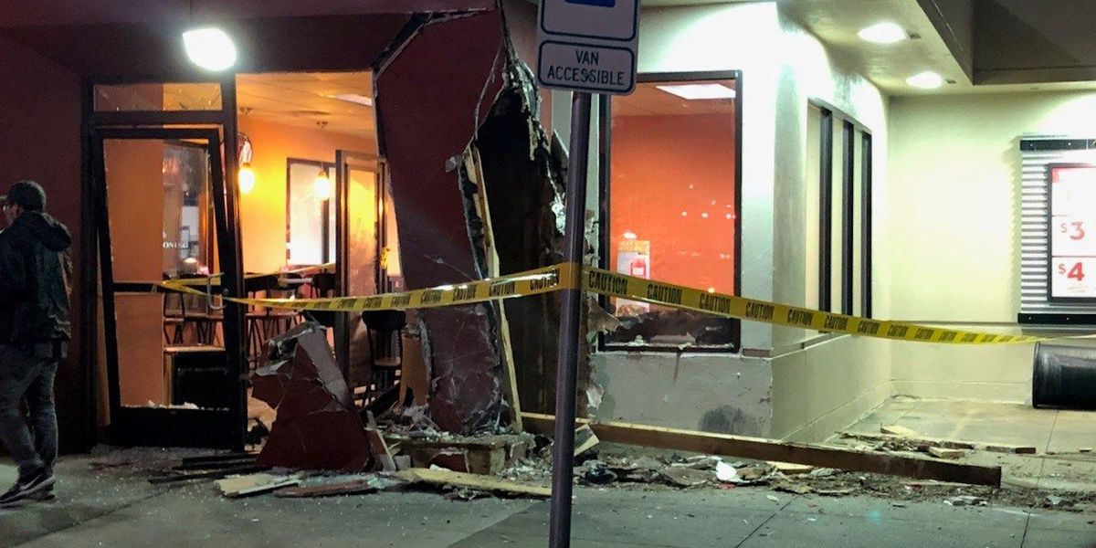 Car drives through front door of Lufkin Jack in the Box