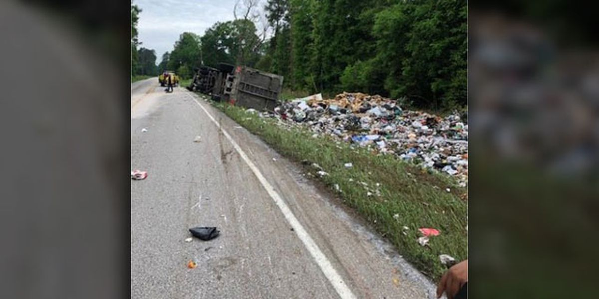 Truck hauling trash overturned in Polk County
