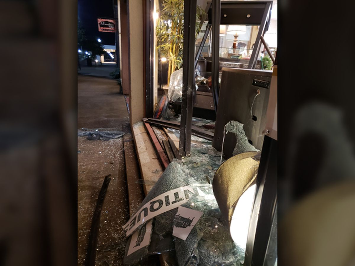 Driving lesson ends through storefront window