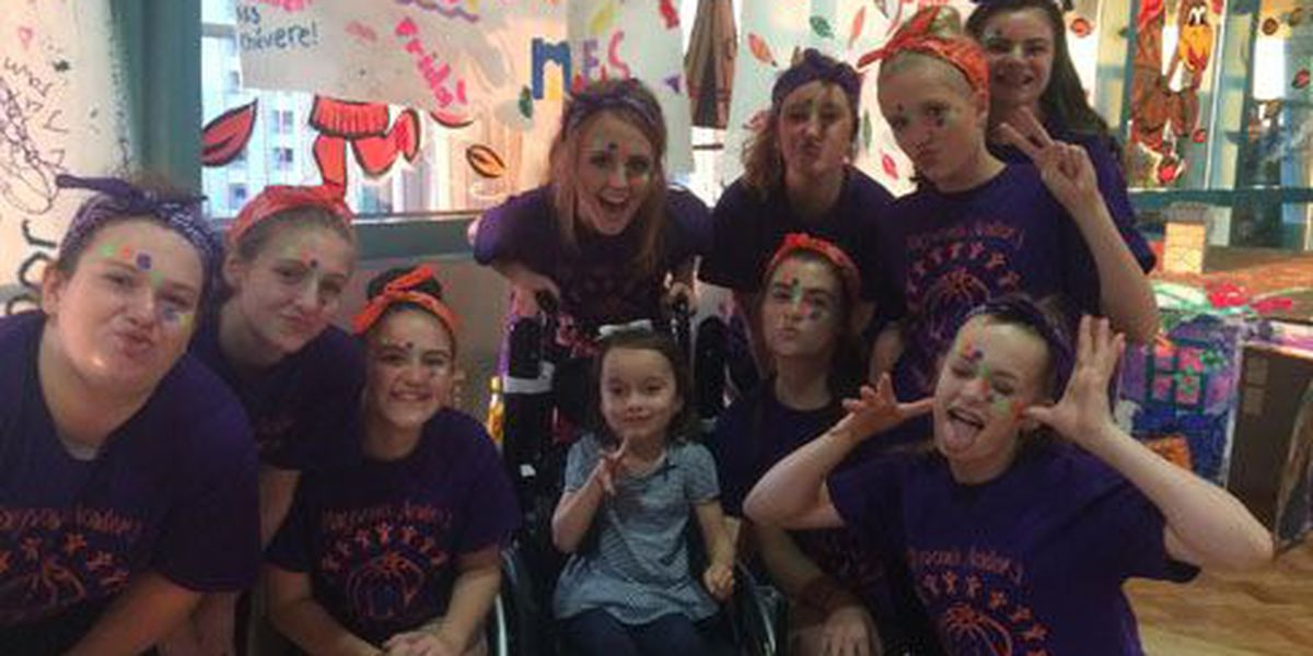 Pineywoods Community Academy cheerleaders bring smiles to young patients