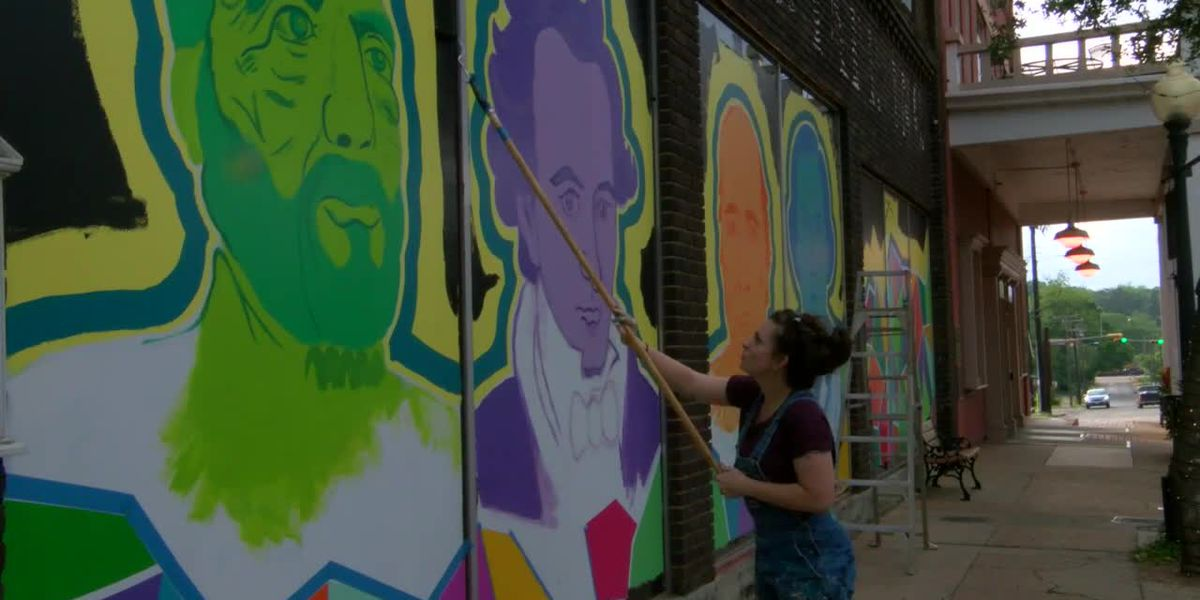 Painter promotes community art through colorful, historical murals in downtown Nacogdoches