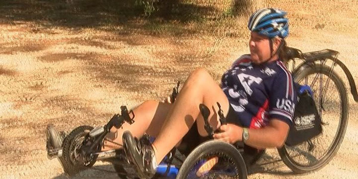 Cancer survivor bikes through Polk County on cross-country mission