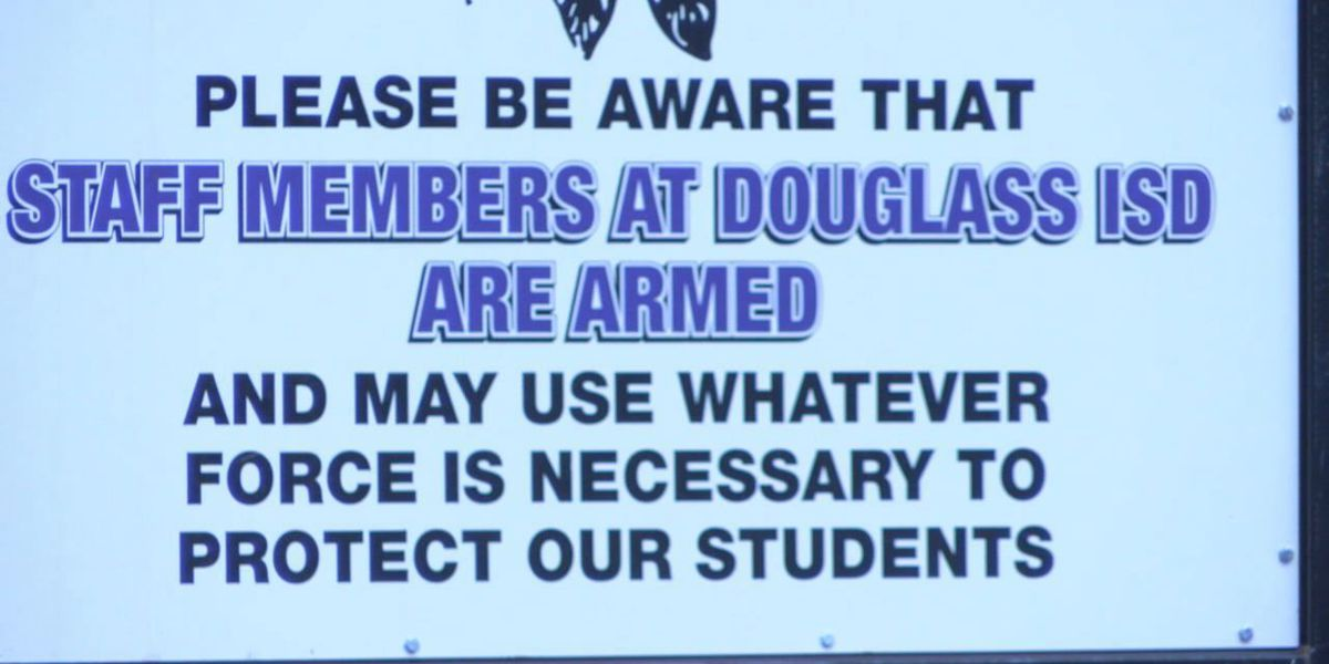 Sign at Douglass ISD warns that staff members are armed, ready to protect students