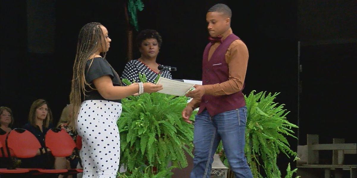 Family of Octavian Burrell present first annual scholarships to students