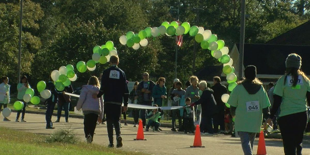 Memorial walk through Hospice in the Pines honors patients
