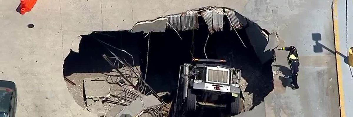 Truck falls through parking garage in N.J.