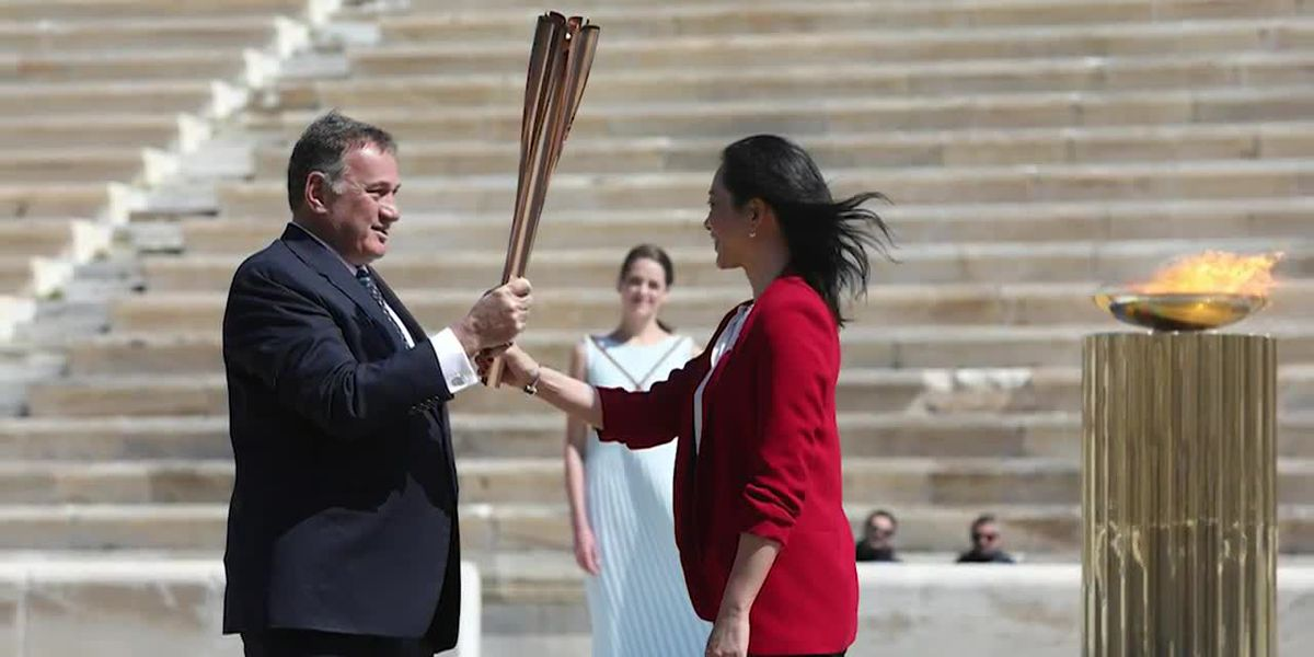 Greece hands Olympic flame over to Japan amid calls to delay 2020 Games