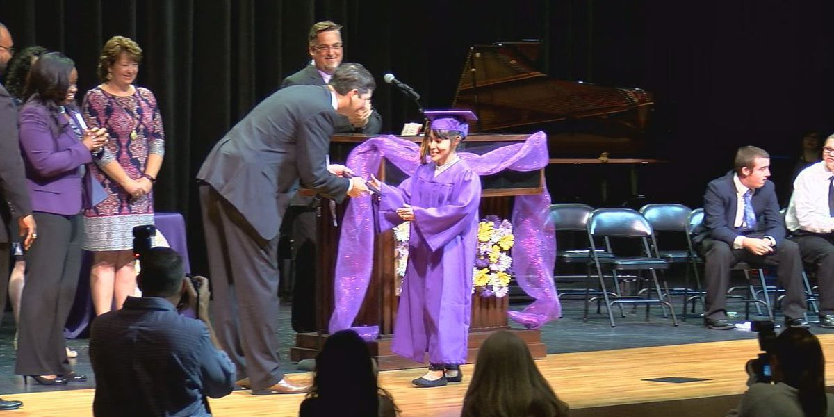6 students walk the stage in LHS Special Education Graduation