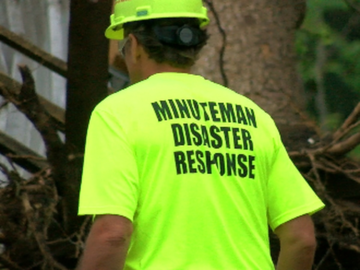 Volunteers with Minuteman Response help cleanup in Alto
