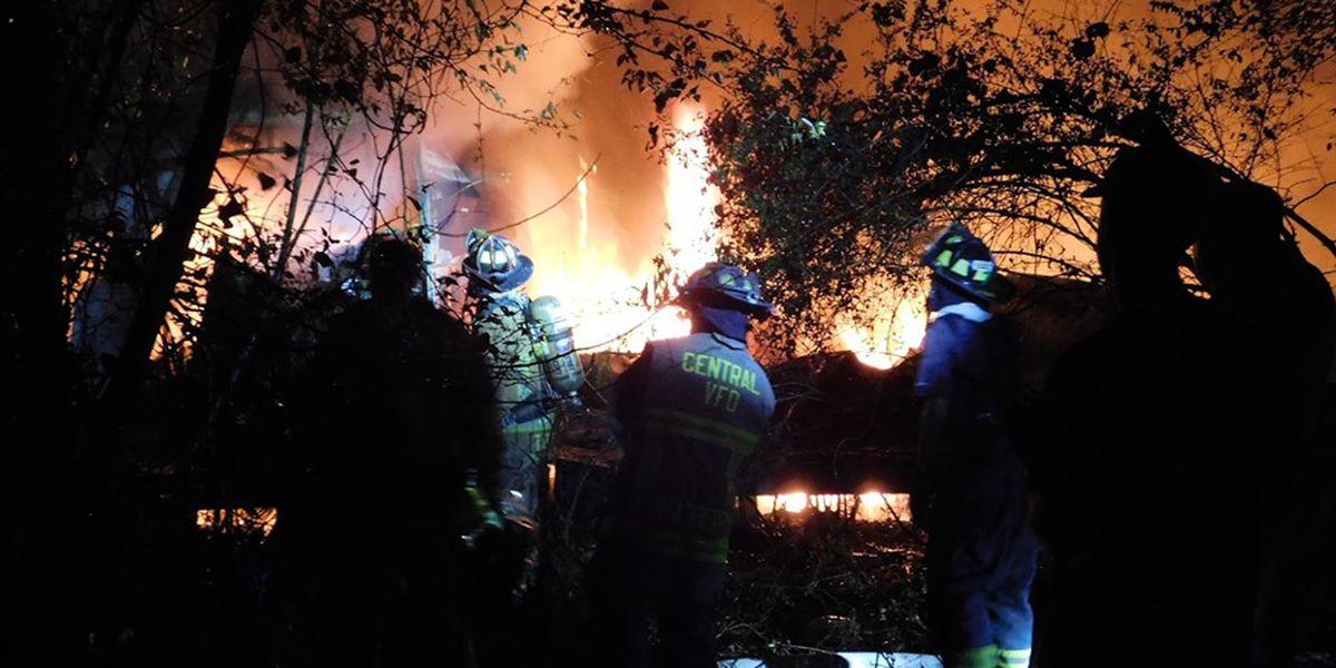 Hudson fire crews extinguish burning home overnight