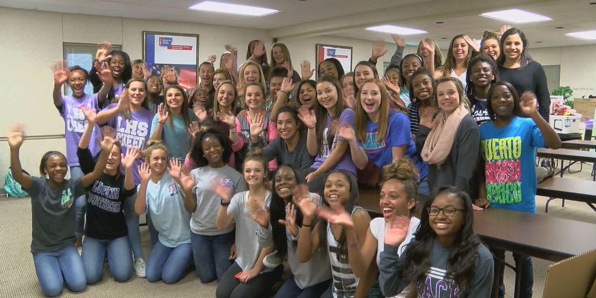 Lufkin High School cheerleaders help prepare for Cattle Baron's Gala