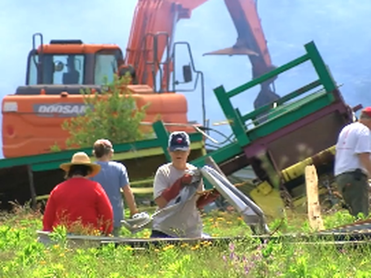 Volunteers help remove debris at Caddo Mounds for tornado recovery