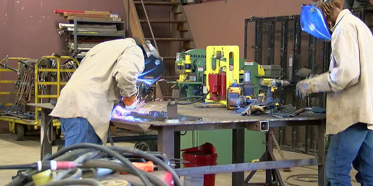 Newton ISD students build no-touch hand sanitizer stands