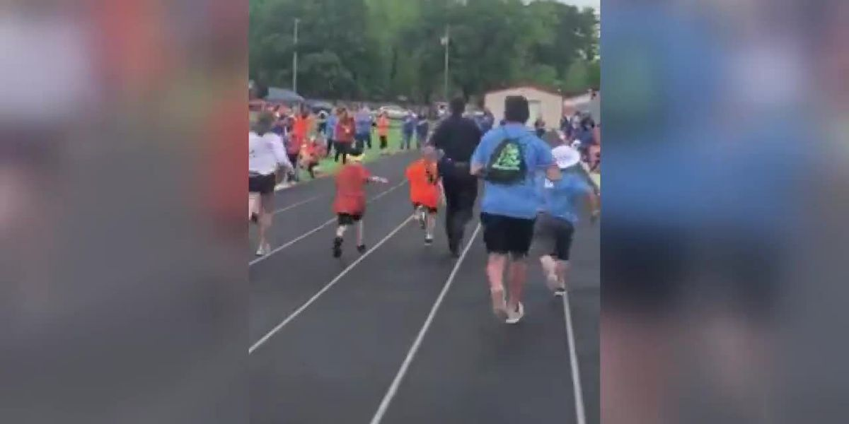 VIDEO: Henderson police officer runs 50-yard dash with students at field day