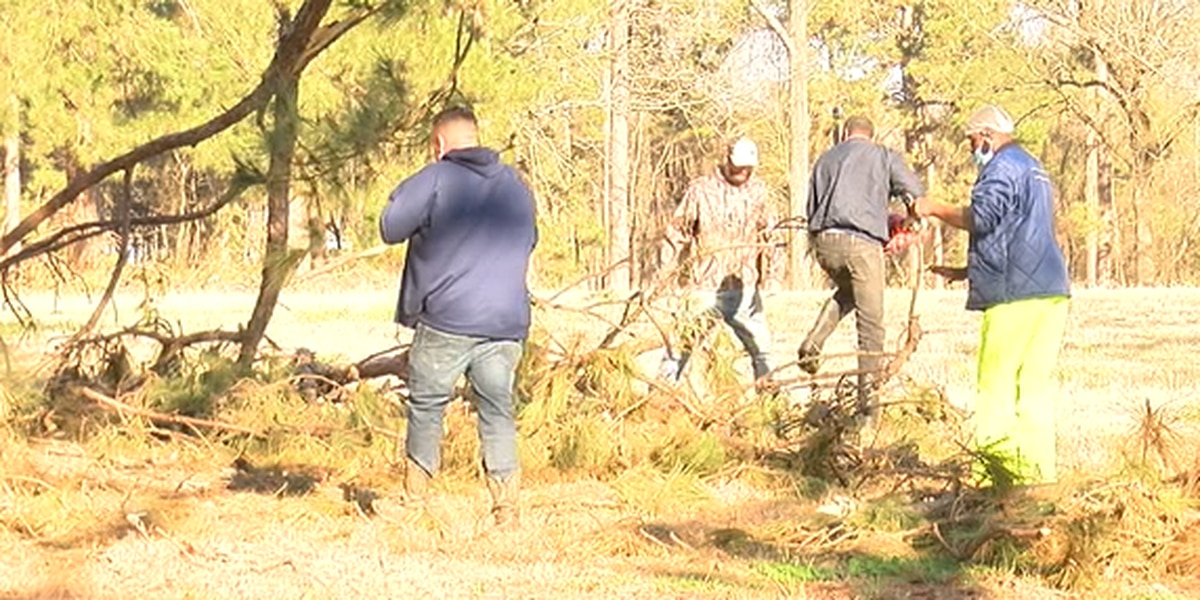 Volunteers work to clean up debris on new Impact Lufkin property after winter storm